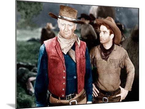 RED RIVER, from left: John Wayne, Montgomery Clift, 1948--Mounted Photo
