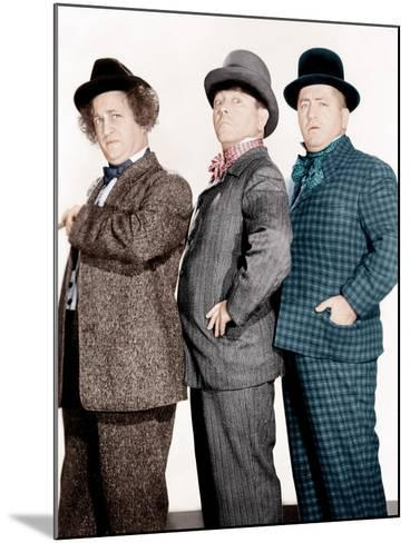 PHONY EXPRESS, from left: Larry Fine, Moe Howard, Curly Howard, (aka The Three Stooges), 1943--Mounted Photo