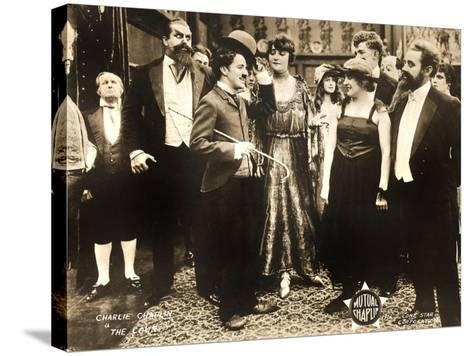 THE COUNT, foreground left: Charlie Chaplin, foreground second from right: Edna Purviance, 1916.--Stretched Canvas Print