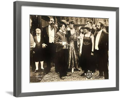 THE COUNT, foreground left: Charlie Chaplin, foreground second from right: Edna Purviance, 1916.--Framed Art Print