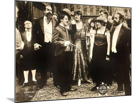 THE COUNT, foreground left: Charlie Chaplin, foreground second from right: Edna Purviance, 1916.--Mounted Art Print