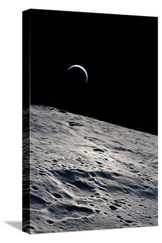 Cresent Earth, As Seen From the Moon--Stretched Canvas Print