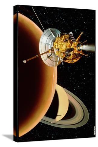 Cassini Spacecraft Near Titan-David Ducros-Stretched Canvas Print
