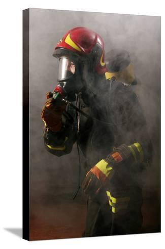 Firefighter-Mauro Fermariello-Stretched Canvas Print