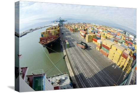 Container Ship And Port-Dr. Juerg Alean-Stretched Canvas Print