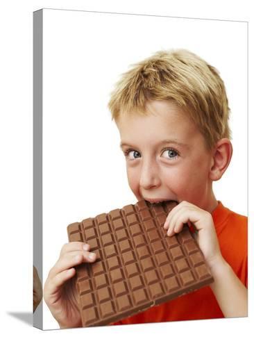 Boy Eating Chocolate-Ian Boddy-Stretched Canvas Print
