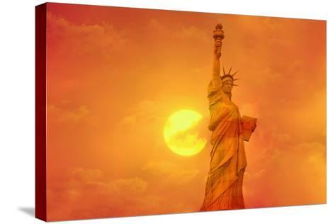 Sunset Behind the Statue of Liberty-Tony Craddock-Stretched Canvas Print