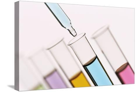 Pipetting Liquid Into Test Tubes-Kevin Curtis-Stretched Canvas Print