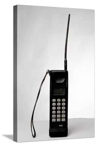 Early Mobile Phone-Victor De Schwanberg-Stretched Canvas Print