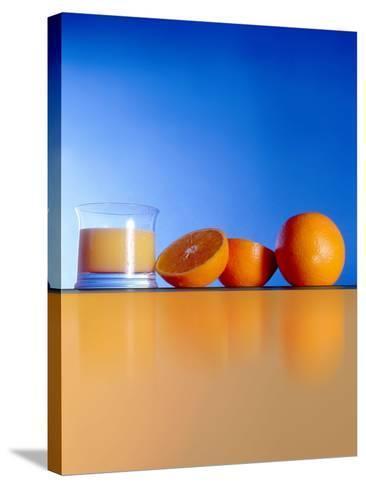 Oranges And Orange Juice-Victor Habbick-Stretched Canvas Print