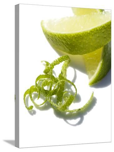 Lime Slices And Peel-Jon Stokes-Stretched Canvas Print