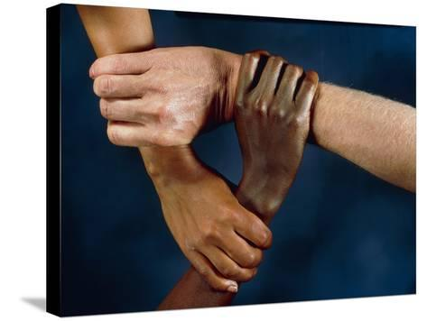 Linked Hands-Tony McConnell-Stretched Canvas Print