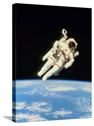 Astronaut Bruce McCandless Walking In Space--Stretched Canvas Print