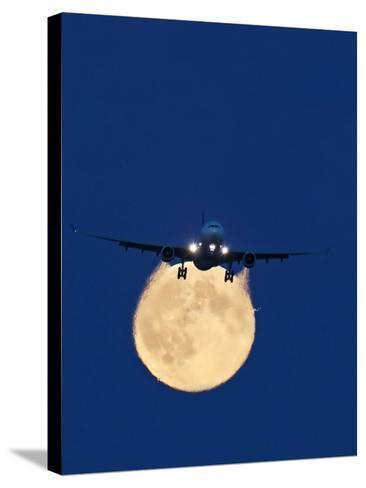 Airbus 330 Passing In Front of the Moon-David Nunuk-Stretched Canvas Print