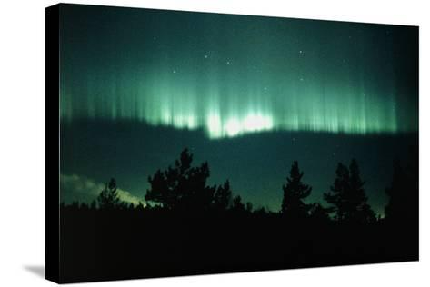 View of An Aurora Borealis Display-Pekka Parviainen-Stretched Canvas Print