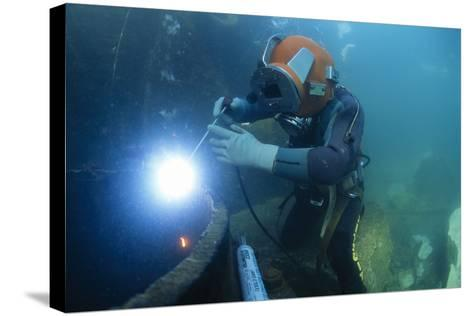 Commercial Diver Welding-Alexis Rosenfeld-Stretched Canvas Print