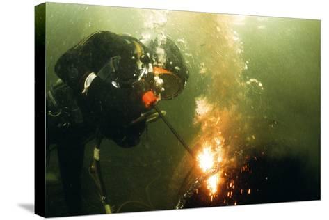 Welding Underwater-Peter Scoones-Stretched Canvas Print