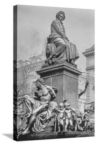 Monument to Ludwig Van Beethoven, the Composer Seated on a Pedestal Above Figures Alluding to the?--Stretched Canvas Print