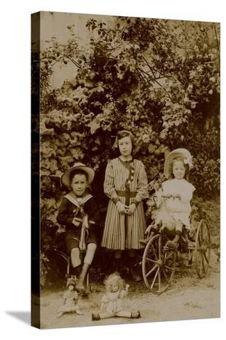 Children with Dolls, Rocking Horse and Tricycle, C.1890--Stretched Canvas Print