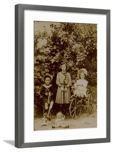 Children with Dolls, Rocking Horse and Tricycle, C.1890--Framed Art Print