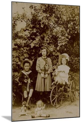 Children with Dolls, Rocking Horse and Tricycle, C.1890--Mounted Photographic Print