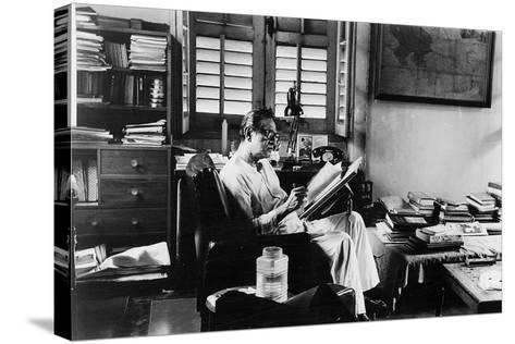 Satyajit Ray at Work in His Apartment--Stretched Canvas Print
