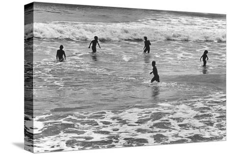 Children Playing in Sea, Somnath--Stretched Canvas Print