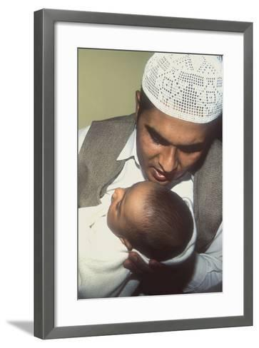 A Father Whispers the Opening Words of the Muslim Shahada in His Newborn Baby's Ear--Framed Art Print
