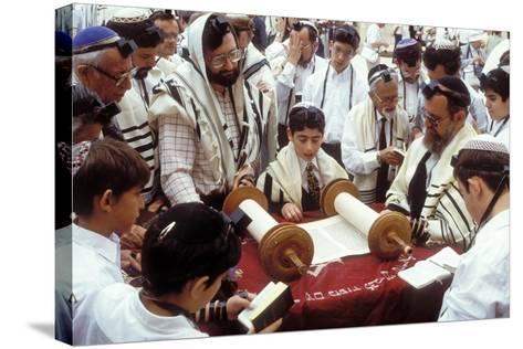 A Boy Reading the Torah During His Bar Mitzvah--Stretched Canvas Print