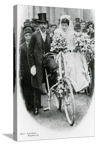 Roman Catholic Couple Leaving Notre Dame De France, Leicester Square, on Bicycles--Stretched Canvas Print