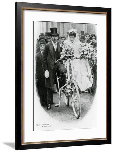 Roman Catholic Couple Leaving Notre Dame De France, Leicester Square, on Bicycles--Framed Art Print