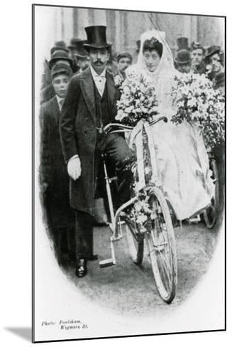 Roman Catholic Couple Leaving Notre Dame De France, Leicester Square, on Bicycles--Mounted Photographic Print