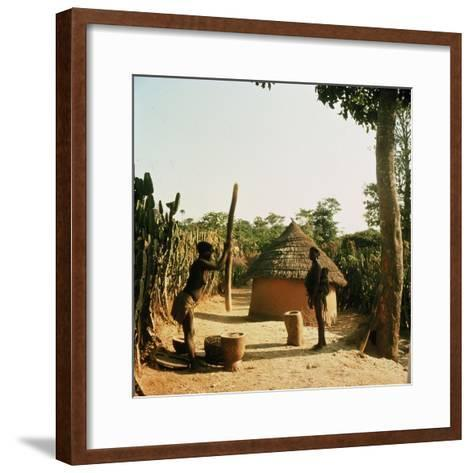 A Woman Grinding Millet with a Pestle and Mortar in a Miango Village Near Jos--Framed Art Print