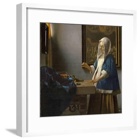 Woman Holding a Balance, C.1664-Johannes Vermeer-Framed Art Print