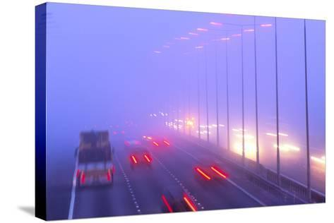 Vehicles Driving Through Fog on a Motorway-Jeremy Walker-Stretched Canvas Print