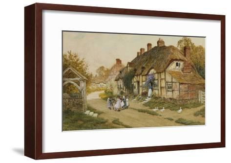 Children Playing Outside a Cottage in a Village-Arthur Claude Strachan-Framed Art Print