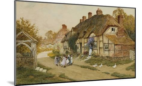Children Playing Outside a Cottage in a Village-Arthur Claude Strachan-Mounted Giclee Print