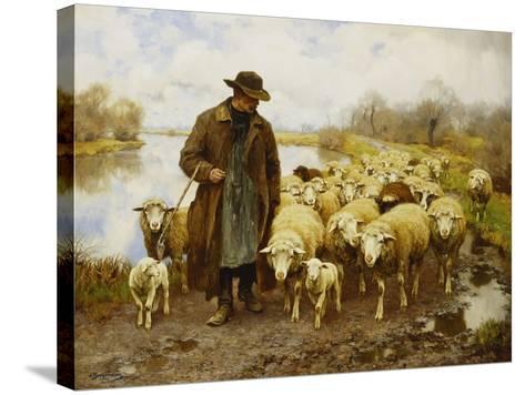 A Shepherd and Sheep by a Lake-Julius Hugo Bergmann-Stretched Canvas Print