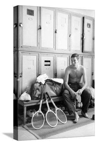 Nicola Pietrangeli in a Changing Room, with Rackets and a Sport Bag--Stretched Canvas Print