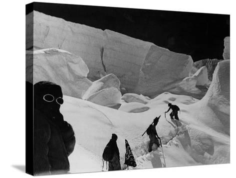 Alpinists Walking in the Snow--Stretched Canvas Print