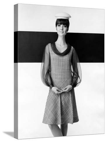 A Model Poses in a High-fashion Dress--Stretched Canvas Print