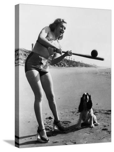 Marilyn Monroe Playing Softball--Stretched Canvas Print