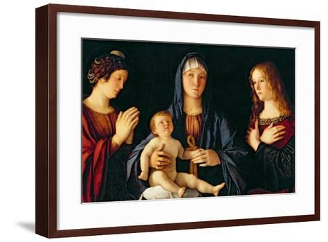 Virgin and Child with St. Catherine and Mary Magdalene, c.1500-Giovanni Bellini-Framed Art Print