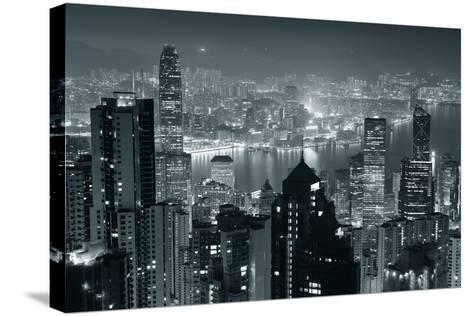 Hong Kong City Skyline At Night With Victoria Harbor And Skyscrapers Illuminated-Songquan Deng-Stretched Canvas Print