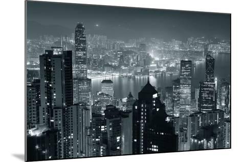 Hong Kong City Skyline At Night With Victoria Harbor And Skyscrapers Illuminated-Songquan Deng-Mounted Art Print