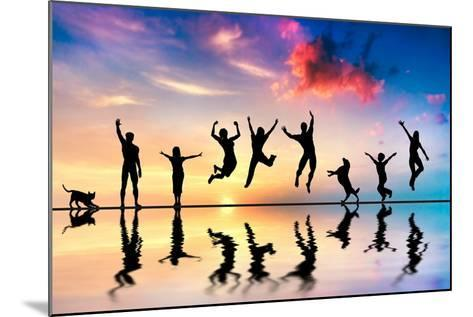 Happy Group Of Friends, Family With Dog And Cat Jumping Together At Sunset, Water Reflection-Michal Bednarek-Mounted Art Print