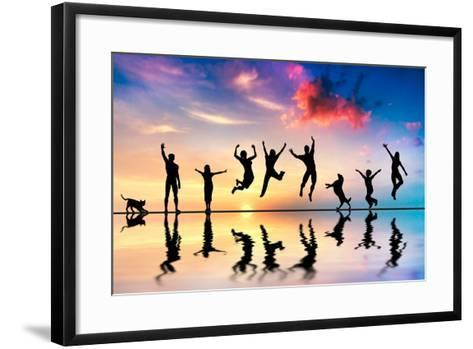 Happy Group Of Friends, Family With Dog And Cat Jumping Together At Sunset, Water Reflection-Michal Bednarek-Framed Art Print