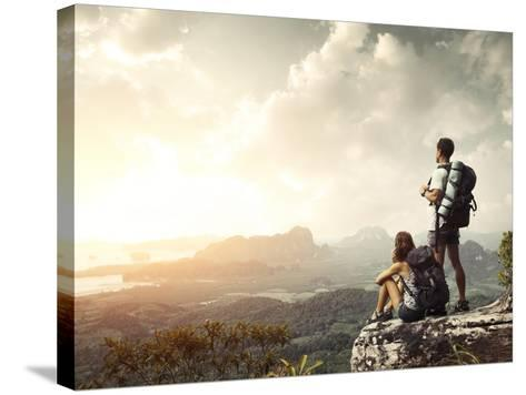 Hikers With Backpacks Enjoying Valley View From Top Of A Mountain-Dudarev Mikhail-Stretched Canvas Print