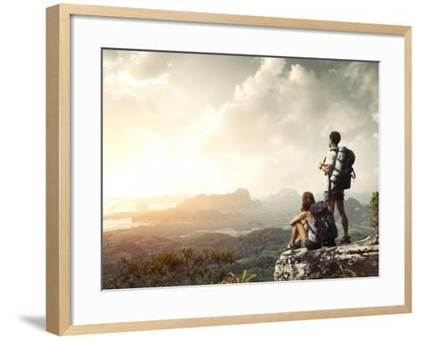 Hikers With Backpacks Enjoying Valley View From Top Of A Mountain-Dudarev Mikhail-Framed Art Print