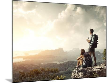 Hikers With Backpacks Enjoying Valley View From Top Of A Mountain-Dudarev Mikhail-Mounted Art Print
